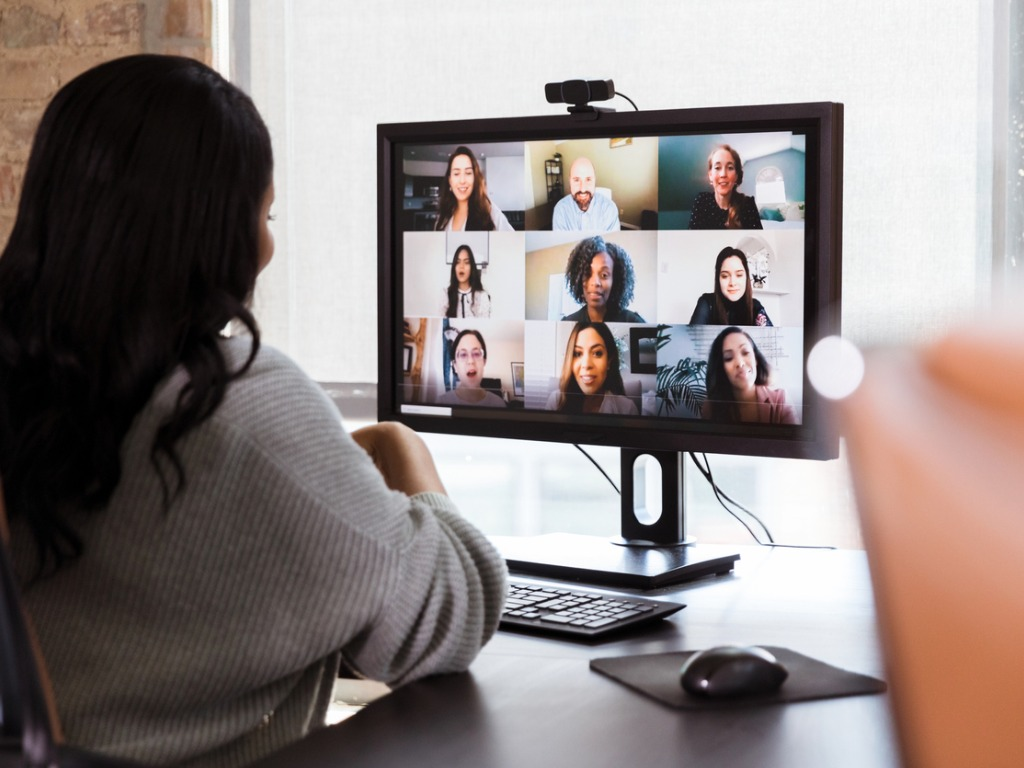 Business Woman Meets With Colleagues During Virtual Webinar
